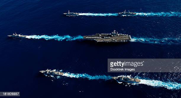 pacific ocean, february 14, 2012 - ships from the john c. stennis carrier strike group transit the pacific ocean during a photo exercise.  - united_states_house_of_representatives_elections_in_florida,_2012 stock pictures, royalty-free photos & images