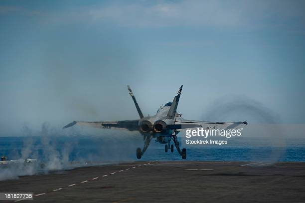 Pacific Ocean, February 16, 2013 - An F/A-18C Hornet launches from the flight deck of the aircraft carrier USS Carl Vinson.