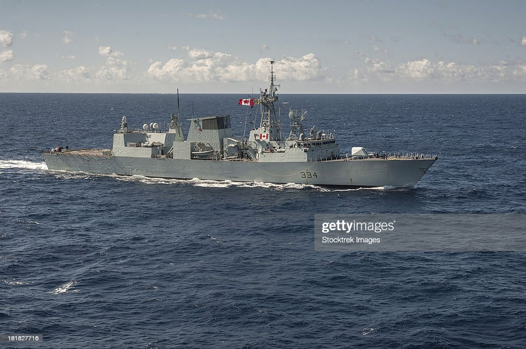Pacific Ocean, January 11, 2013 - The Canadian frigate HMCS Regina (FFH 334) sails into position for a passing exercise. : Stock Photo