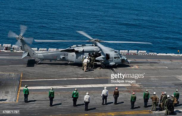 Pacific Ocean, May 7, 2013 - Commander of Naval Air Forces arrives aboard the aircraft carrier USS Carl Vinson (CVN-70).