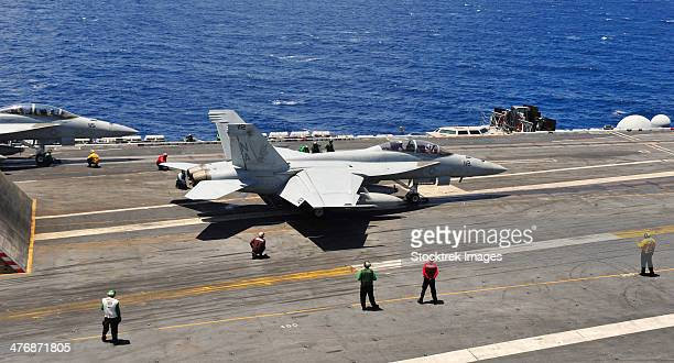 Pacific Ocean, May 9, 2013 - An F/A-18E Super Hornet prepares to launch from the aircraft carrier USS Carl Vinson.