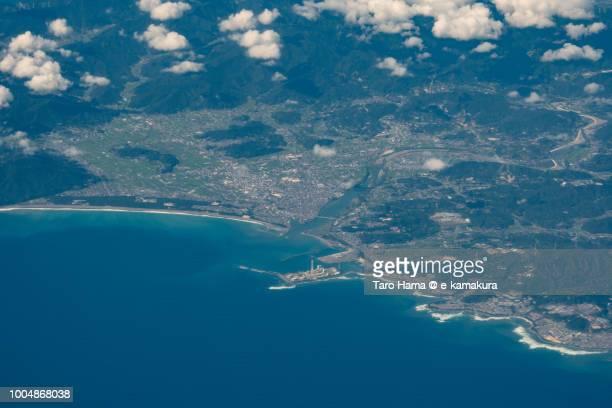 pacific ocean, mihama town and gobo city in wakayama prefecture in japan daytime aerial view from airplane - präfektur wakayama stock-fotos und bilder