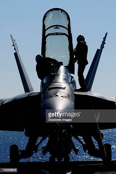Pacific Ocean (January 23, 2007) - Pilots conducts a pre-flight inspection on an F/A-18F Super Hornet assigned to the Black Knights of Strike Fighter Squadron One Five Four on the flight deck aboard the Nimitz-class aircraft carrier USS John C. Stennis.