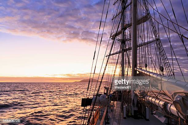 Pacific Ocean, sailing ship at Galapagos Islands at sunset