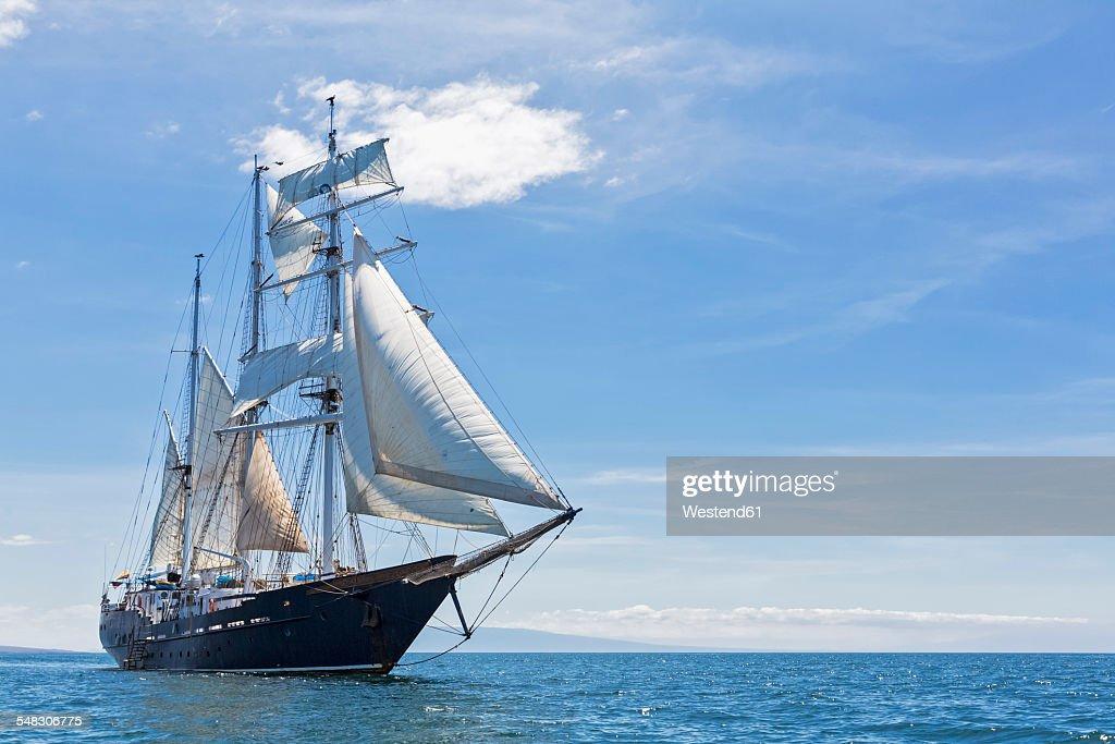 Pacific Ocean, sailing ship under sail at Galapagos Islands : Stock Photo