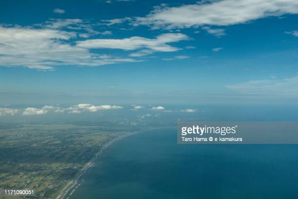 pacific ocean, sousa and asahi cities in chiba prefecture of japan daytime aerial view from airplane - chiba city fotografías e imágenes de stock