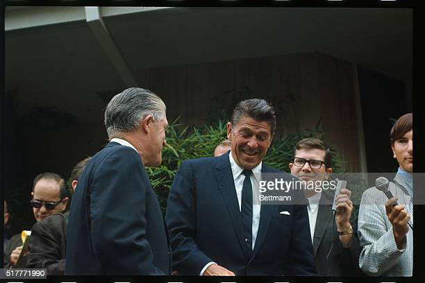 California Governor Ronald Reagan enjoys a laugh in front of his home with Michigan Governor George Romney September 24th As the two met with newsmen...