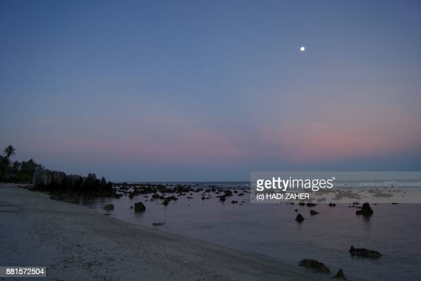 pacific sunset and the full moon | nauru - nauru stock pictures, royalty-free photos & images