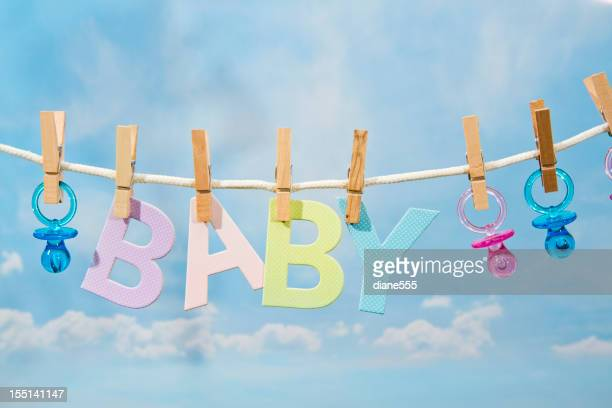 Pacifiers and BABY Letters Hanging On A Clothesline