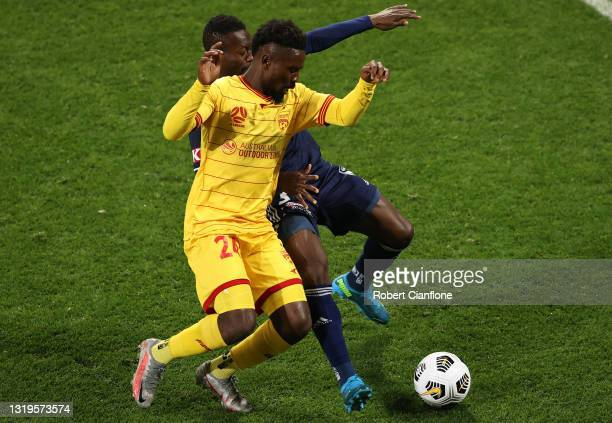 Pacifique Niyongabire of Adelaide United and Adama Traore of the Victory compete for the ball during the A-League match between Melbourne Victory and...