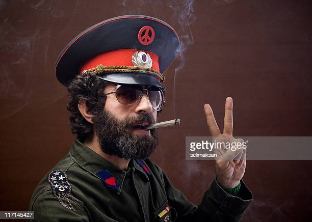 pacifist general in military officier uniform making peace sign - general military rank stock photos and pictures