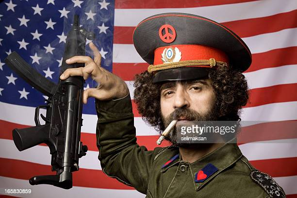 Pacifist in military uniform leaving his weapon before American flag