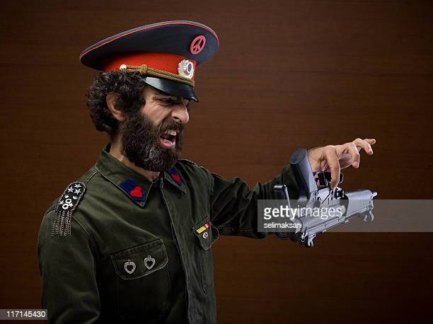pacifist military general leaving his weapon for peace - general military rank stock photos and pictures