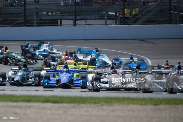 A pack of cars during the INDYCAR Grand Prix on May 13 at the Indianapolis Motor Speedway in Indianapolis Indiana