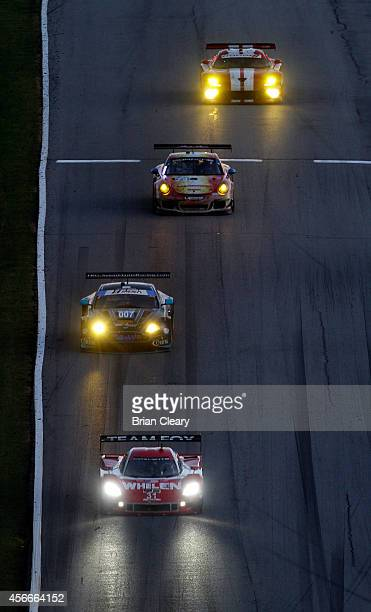 Pack of cars races down a hill at Petit Le Mans at Road Atlanta on October 4, 2014 in Braselton, Georgia.