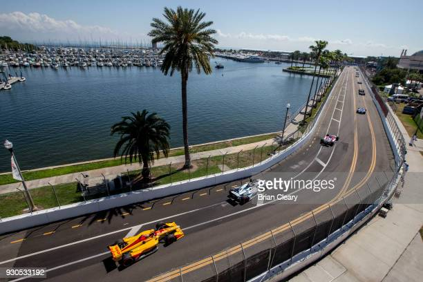 Pack of cars races down a tree-lined street during the Firestone Grand Prix of Saint Petersburg IndyCar race on March 11, 2018 in Saint Petersburg,...
