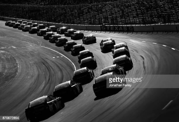 A pack of cars races during the Monster Energy NASCAR Cup Series AAA Texas 500 at Texas Motor Speedway on November 5 2017 in Fort Worth Texas