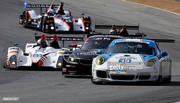 A pack of cars races through a turn during practice for the Continental Tire Monterey Grand Prix Powered by Mazda at Mazda Raceway Laguna Seca on May...
