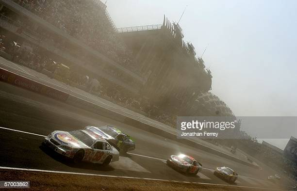 Pack of cars races through dusty conditions on the front stretch during the NASCAR Busch Series Telcel-Motorola 200 on March 5, 2006 at Autodromo...