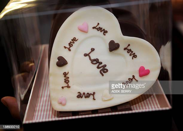 A pack of chocolates is displayed for Valentine's Day on sale at a shop in Jakarta on February 14 2012 Many Indonesian celebrated Valentine's Day...