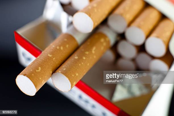 Pack of Cigarettes with two hanging over pack