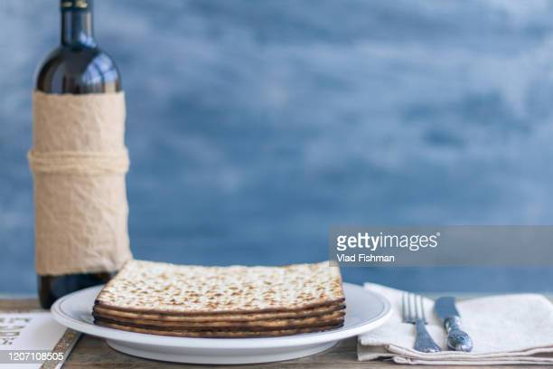 pack of matzah and red kosher - happy passover stock pictures, royalty-free photos & images