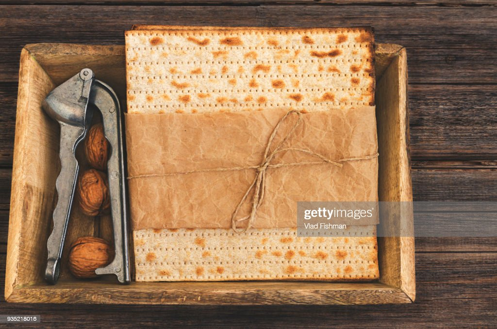 Pack of matzah or matza on a vintage wood background presented as a gift. : Stock Photo
