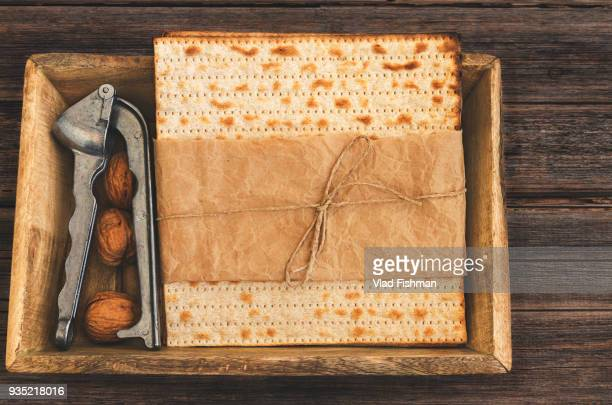 Pack of matzah or matza on a vintage wood background presented as a gift.