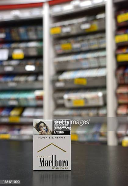 A pack of Philip Morris International Inc Marlboro Gold cigarettes in the old packaging is arranged for a photograph at a tobacco store in Melbourne...
