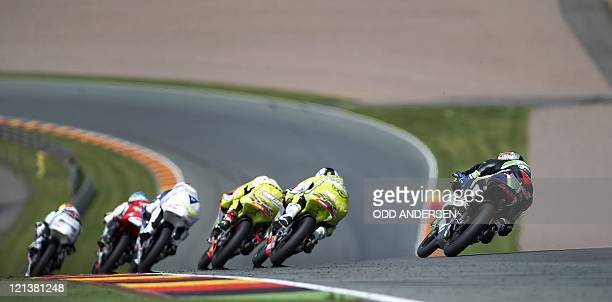 A pack of riders races on July 17 2011 during the 125cc motorcycling race of the German Grand Prix at the Sachsenring racetrack in...