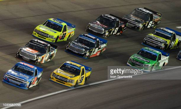 A pack of trucks led by Stewart Friesen We Build America Chevrolet Silverado race into turn three Friday September 14 during the NASCAR Camping World...