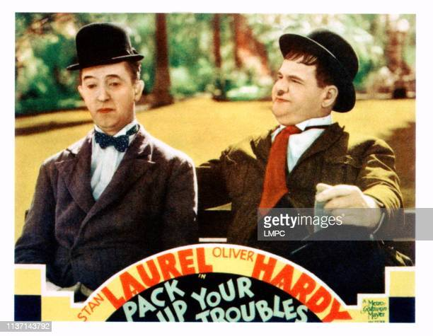 Pack Up Your Troubles lobbycard from left Stan Laurel Oliver Hardy on lobbycard 1932