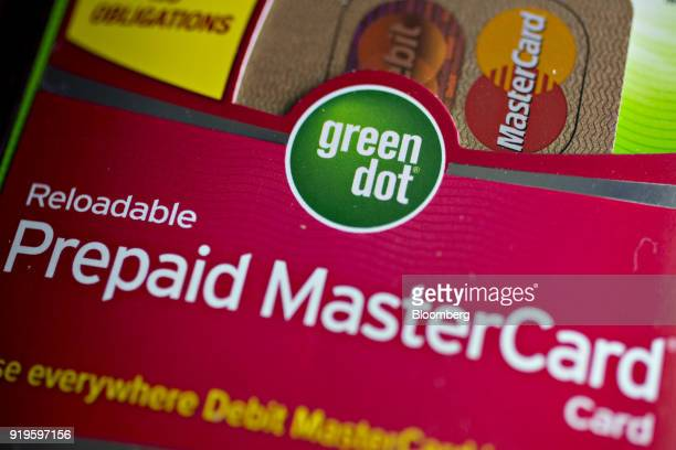 A package containing a Green Dot Corp prepaid Mastercard Inc debit card is arranged for a photograph in Washington DC US on Thursday Feb 15 2018...