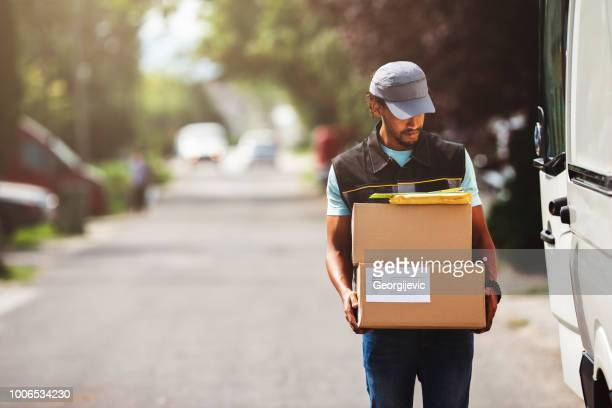 package delivery - delivery person stock pictures, royalty-free photos & images