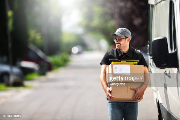 package delivery - receiving stock pictures, royalty-free photos & images