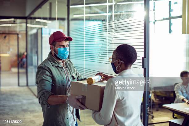 package delivery to the office - small business stock pictures, royalty-free photos & images