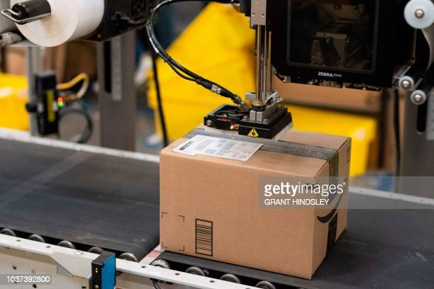 A package is labeled at a SLAM or scan label apply and manifest during a tour of Amazon's Fulfillment Center September 21 2018 in Kent Washington