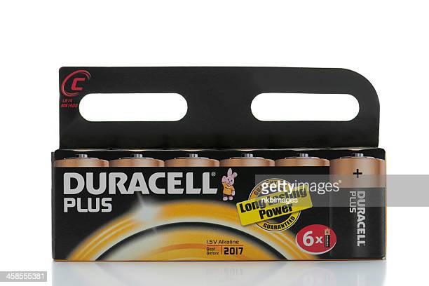 package of 6 duracell c batteries on white background - duracell stock pictures, royalty-free photos & images
