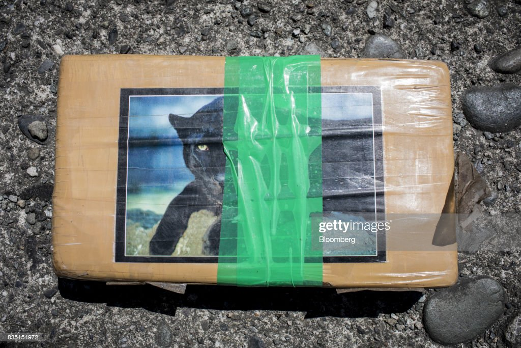 A package of cocaine, seized inside a shipping container at the Buenaventura port, is seen following an anti-narcotics police raid in Buenaventura, Colombia, on Thursday, Aug. 10, 2017. The United Nations Office of Drugs and Crime (UNODC) released a report stating that coca crops in Colombia has increased over fifty percent in one year. The Trump administration has been putting pressure on Colombia to curb the flow of drugs into the U.S. Photographer: Nicolo Filippo Rosso/Bloomberg via Getty Images