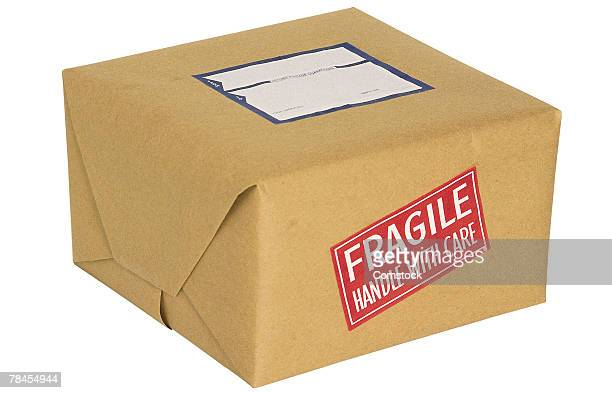 package with fragile sticker - fragile sticker stock pictures, royalty-free photos & images