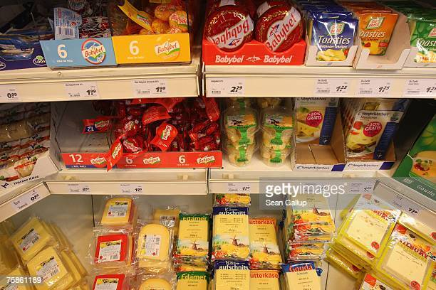 Packaged cheese lies on display in a supermarket counter July 30 2007 in Berlin Germany German milk producers have announced they will raise prices...