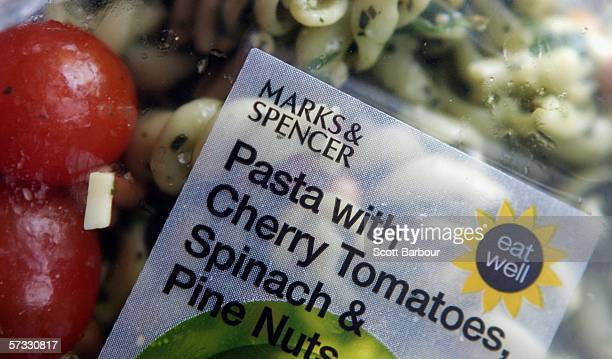 A packaged food item sits on display in the food department of a Marks and Spencer store on April 11 2006 in London England Marks and Spencer...