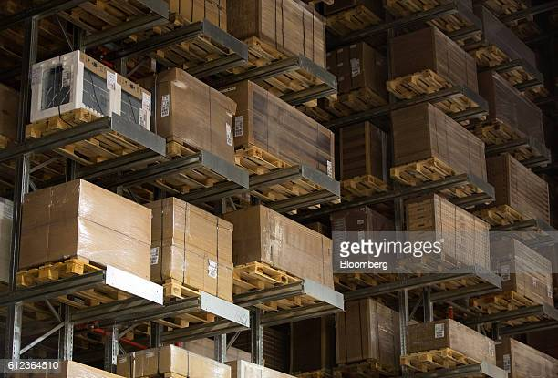 Packaged goods sit on pallets on high shelving in a storage aisle at the Ikea AB distribution center in Yesipovo village near Moscow on Monday Oct 3...