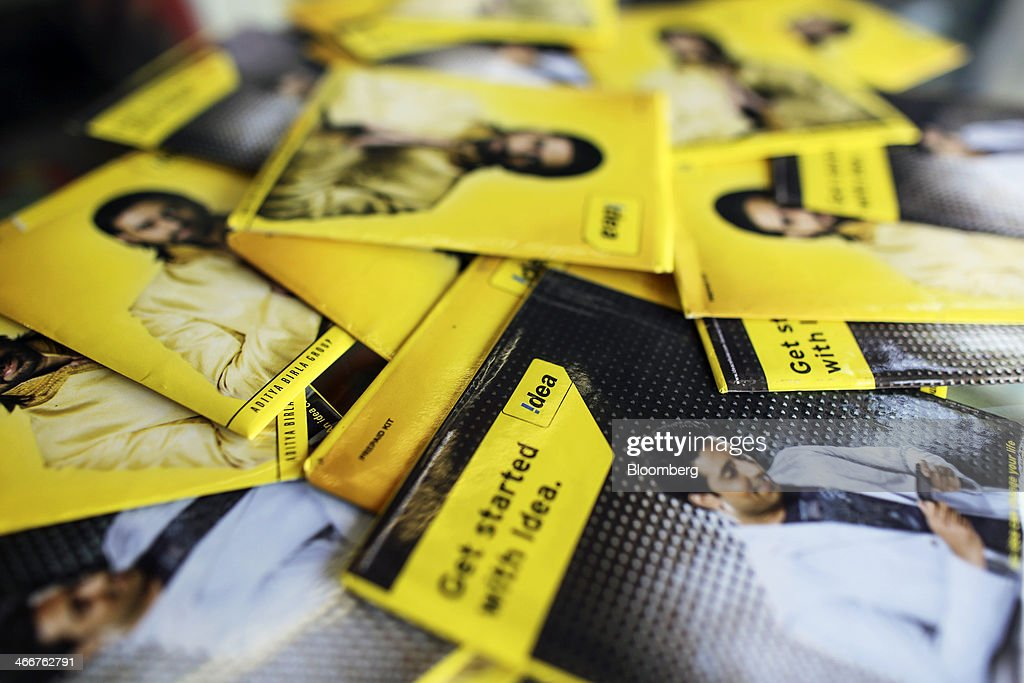 Packaged Idea Cellular Ltd. prepaid mobile telephone SIM cards are arranged for a photograph at a mobile phone store in Mumbai, India, on Wednesday, Jan. 29, 2014. India got bids totaling 446.1 billion rupees ($7.12 billion) on the first day of a wireless spectrum auction on Feb. 3, the third effort by the government to raise revenue from the sale of airwaves in the last 15 months. Photographer: Dhiraj Singh/Bloomberg via Getty Images