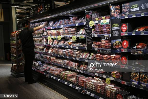 Packaged meats sit on display in a chilled cabinet in the newly refurbished Marks Spencer Group Plc Food shop in London UK on Thursday Oct 17 2019...