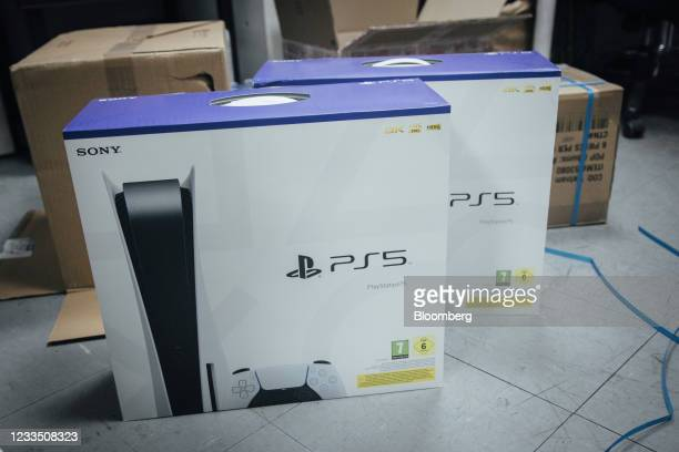 Packaged PlayStation 5 consoles at a video games store in Paris, France, on Thursday, June 17, 2021. The reinstatement of Cyberpunk 2077 to the...