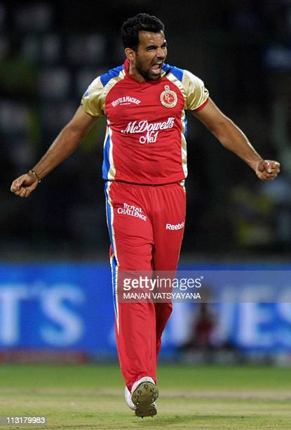PACKAGERoyal Challengers Bangalore fastbowler Zaheer Khan celebrates after taking the wicket of Delhi Daredevils cricketer David Warner during the...