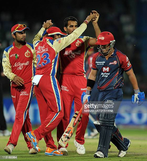 PACKAGERoyal Challengers Bangalore fastbowler Zaheer Khan celebrates with teammates after taking the wicket of Delhi Daredevils cricketer David...
