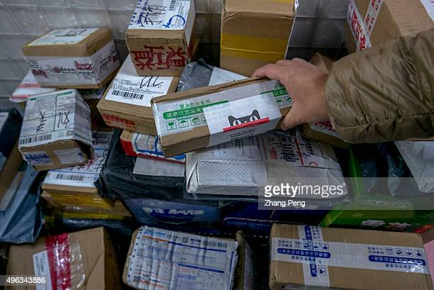 Packages are piled up in a small shop's Cainiao service station the logistics affiliate of Alibaba which offers a special arrangements of delivering...