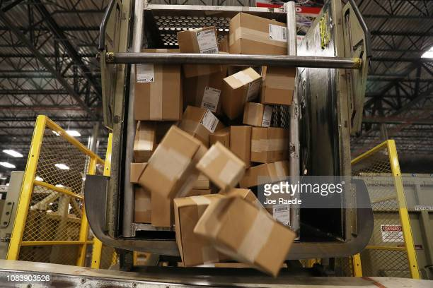 Packages are seen as they are sorted at the US Postal service's Royal Palm Processing and Distribution Center on December 17 2018 in Opa Locka...